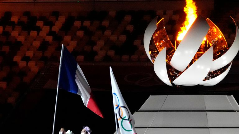 Steven Da Costa, of France, left, attends the closing ceremony in the Olympic Stadium at the 2020 Summer Olympics, Sunday, Aug. 8, 2021, in Tokyo, Japan. (AP Photo/David Goldman)