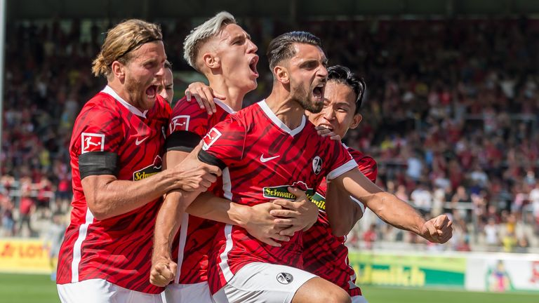 Vincenzo Grifo of Freiburg celebrates after scoring his team's first goal with teammates