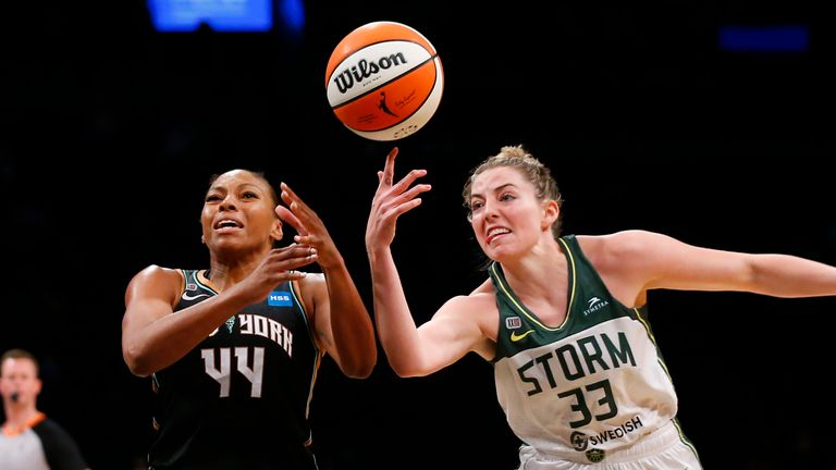 Seattle Storm forward Katie Lou Samuelson (33) knocks the ball out of the hands of New York Liberty guard/forward Betnijah Laney (44) during the second half of a WNBA basketball game Wednesday, Aug. 18, 2021, in New York.