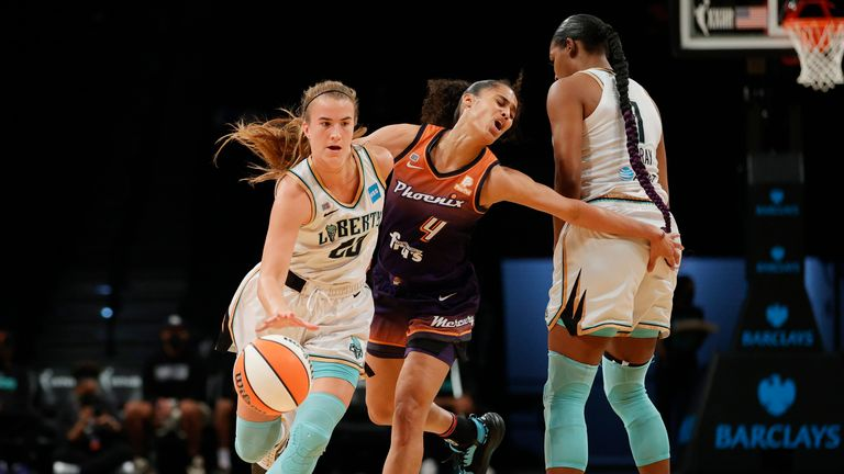 Sabrina Ionescu #20 of the New York Liberty dribbles as Skylar Diggins-Smith #4 of the Phoenix Mercury defends during the first half at Barclays Center on August 25, 2021 in the Brooklyn borough of New York City.