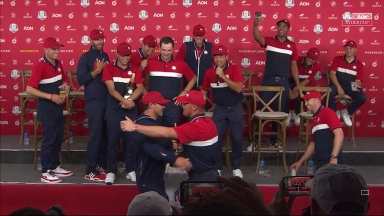 DeChambeau and Brooks Koepka Put Their Rivalry Aside to Embrace with the Ryder Cup trophy