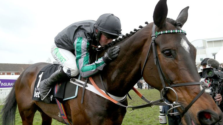 Altior gets a kiss from jockey Nico de Boinville after victory at Cheltenham