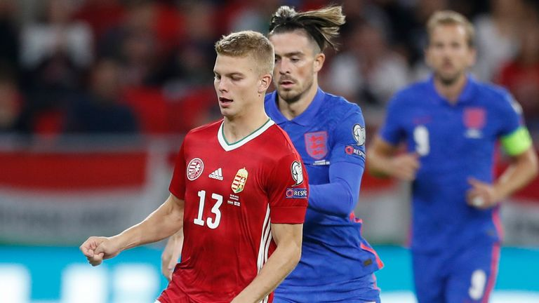 Hungary's Andras Schaefer is chased by Jack Grealish