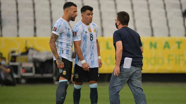 Argentina players are confronted during their match with Brazil