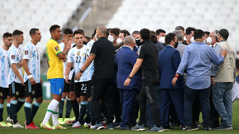 Argentina and Brazil players are surrounded by officials during their World Cup qualifier