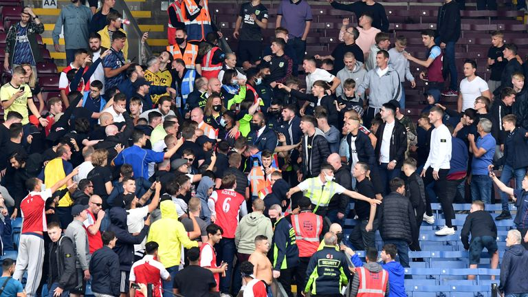 Unsavoury scenes marred the end of the game as Arsenal and Burnley fans threw missiles at each other and had to be separated by stewards at Turf Moor.