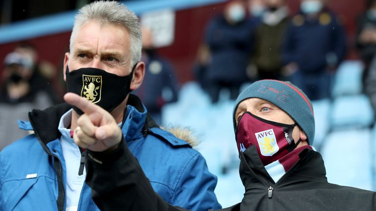 Aston Villa fans wear masks to curb the spread of COVID-19