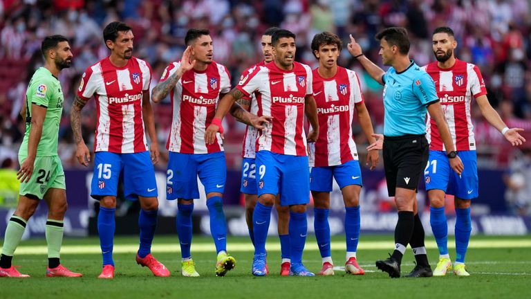 Atletico Madrid's Joao Felix reacts after receiving a red card