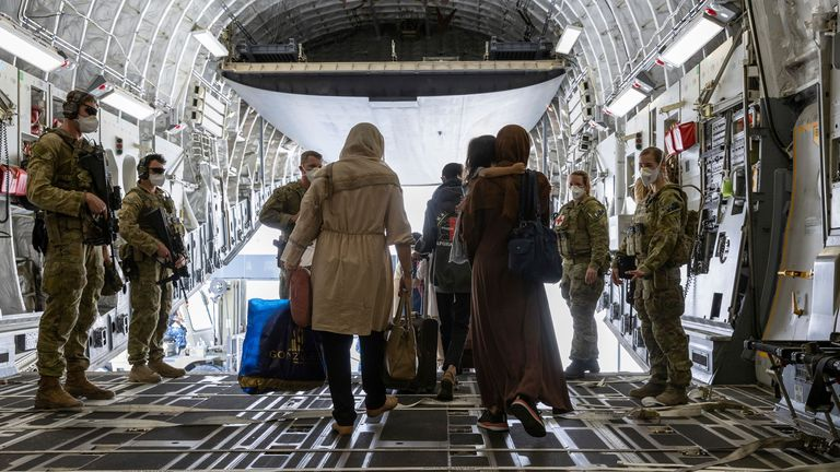 In this image provided by the Australian Defence Force on Aug. 22, 2021, Afghanistan evacuees arrive at Australia...s main operating base in the Middle East, on board a Royal Australian Air Force C-17A Globemaster. The government has not commented on media reports that Australia plans to evacuate 600 Australians and Afghans. (Leading Aircraftwoman Jacqueline Forrester/Australian Defence Force via AP)