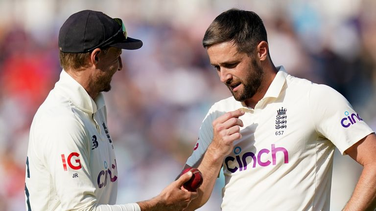 Woakes (right) picked up three wickets on a day of toil for England's bowlers