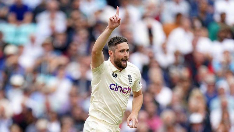 Woakes celebrates taking the wicket of India's Rohit Sharma