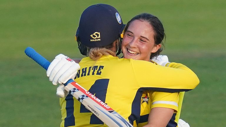 Alice Capsey (R) embraces South East Stars team-mate Kirstie White after hitting the winning runs to win the inaugural Charlotte Edwards Cup against Northern Diamonds (PA Images)