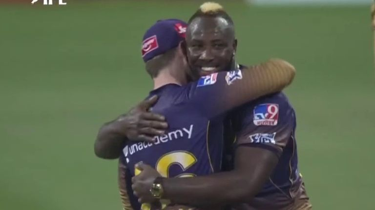 Kolkata Knight Riders' Andre Russell hugs captain Eoin Morgan after yorking AB de Villiers for a duck in the IPL game against Royal Challengers Bangalore
