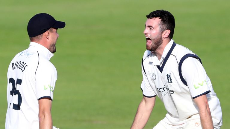 Warwickshire's Liam Norwell (R) celebrates with captain Will Rhodes after taking the wicket that sealed the 2021 County Championship title (PA Images)