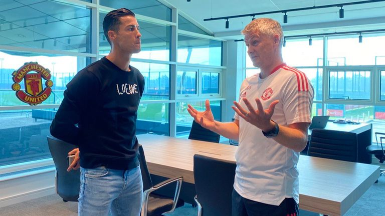 Cristiano Ronaldo speaks to manager Ole Gunnar Solskjaer on his return to Manchester United