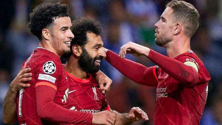 Curtis Jones celebrates with Mo Salah and Jordan Henderson