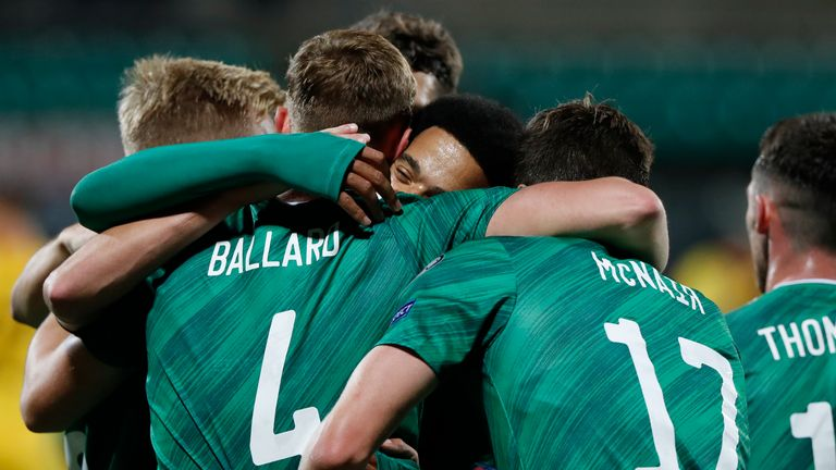 Daniel Ballard celebrates with teammates after scoring Northern Ireland's opener against Lithuania