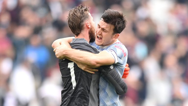 David de Gea celebrates with Harry Maguire after saving a late penalty from Mark Noble