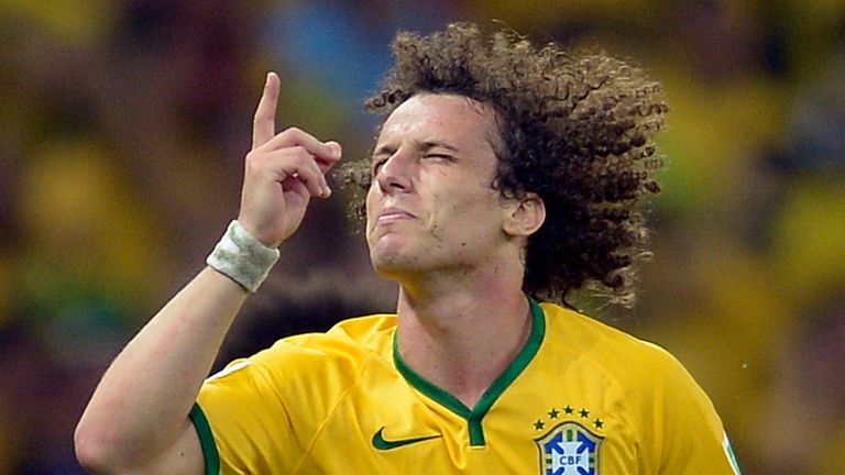 AP - Brazil's David Luiz celebrates after he scored his side's second goal during the World Cup quarterfinal soccer match between Brazil and Colombia at the Arena Castelao in Fortaleza, Brazil, Friday, July 4, 2014.  (AP Photo/Manu Fernandez)