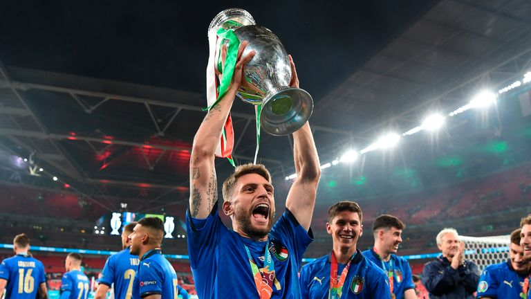 Italy's Domenico Berardi celebrates with the trophy after the final of the Euro 2020 soccer final match between England and Italy at Wembley stadium in London, Sunday, July 11, 2021. (Andy Rain/Pool Photo via AP)