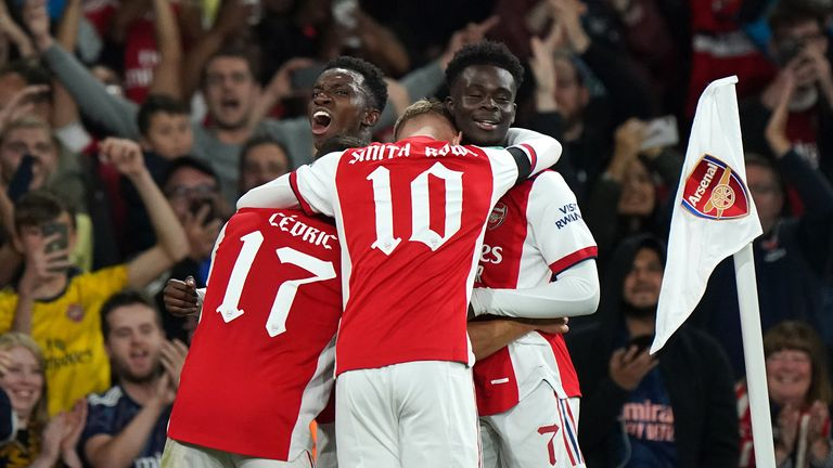 Arsenal's Eddie Nketiah (left, facing) celebrates with team-mates after scoring their side's third goal of the game during the Carabao Cup third round match at the Emirates Stadium