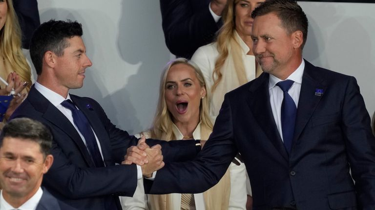 Rory McIlroy shakes hands with Ian Poulter after it was announced they would play together