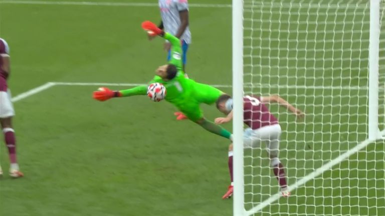 Lukas Fabianski saves from Bruno Fernandes in West Ham's clash with Manchester United.