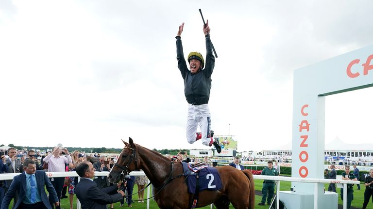 Frankie Dettori performs his famous flying dismount from Stradivarius after winning the Doncaster Cup