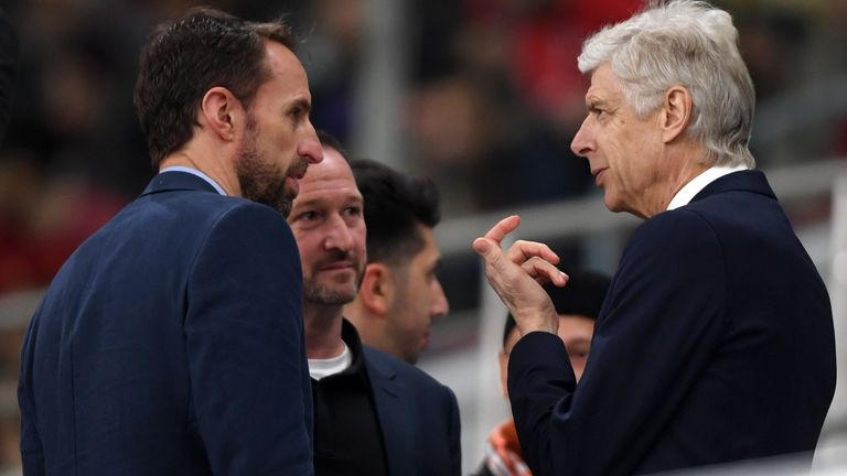 DOHA, QATAR - DECEMBER 18: Gareth Southgate, Manager of England (L) speaks to Arsene Wenger, Head of Global Football Development at FIFA (R) during the FIFA Club World Cup semi-final match between Monterrey and Liverpool FC at Khalifa International Stadium on December 18, 2019 in Doha, Qatar. (Photo by Mike Hewitt - FIFA/FIFA via Getty Images)