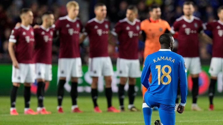 Glen Kamara takes a knee in front of Sparta Prague players