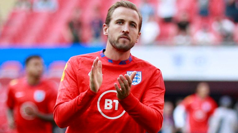 England's Harry Kane applauds the fans during warmup before the World Cup 2022 group I qualifying soccer match between England and Andorra at Wembley stadium in London, Sunday, Sept. 5, 2021. (AP Photo/Ian Walton)