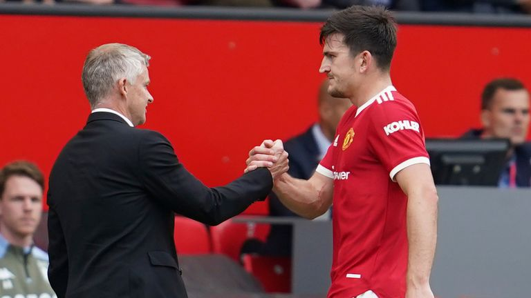 Harry Maguire shakes hands with Ole Gunnar Solskjaer as he leaves the pitch (AP)