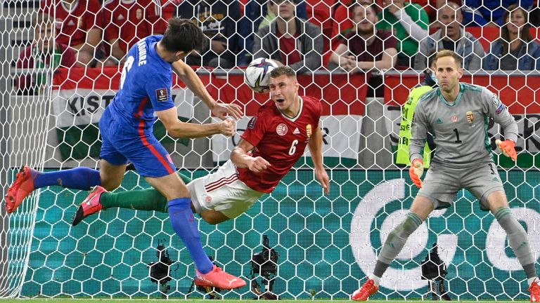 Harry Maguire heads at goal during the first half of Hungary vs England