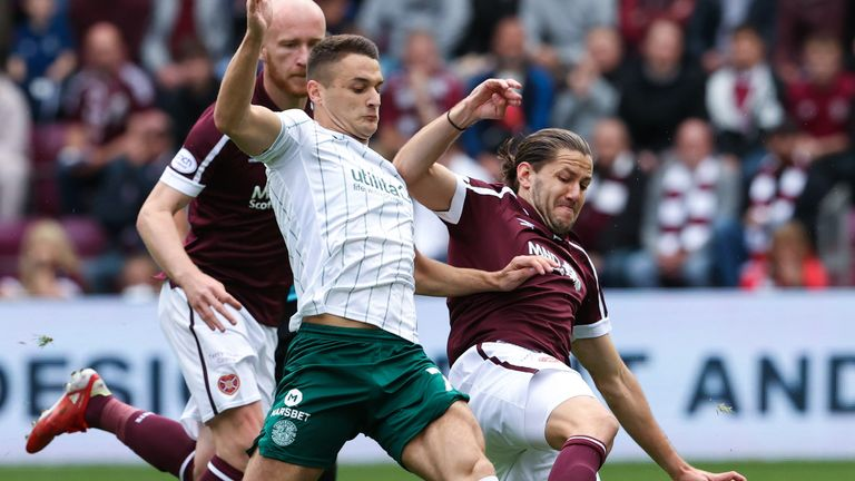 Kyle Magennis and Peter Haring battle for possession