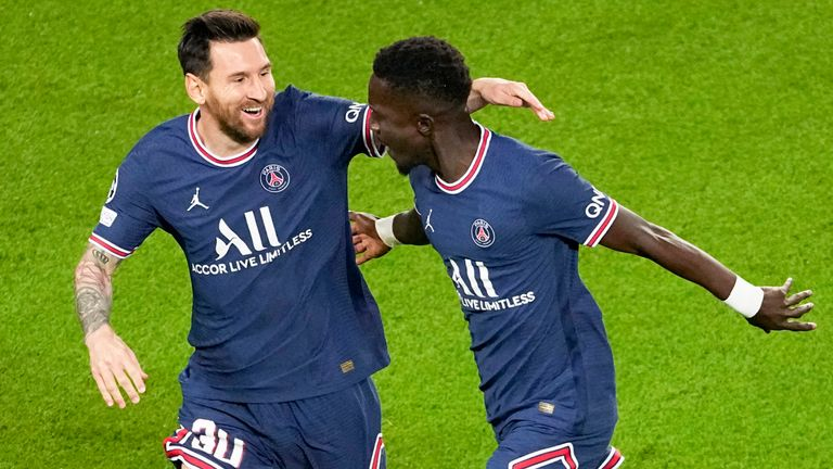 PSG's Idrissa Gueye, right, celebrates with teammate Lionel Messi after scoring his team's first goal during the Champions League Group A soccer match between Paris Saint-Germain and Manchester City at the Parc des Princes in Paris, Tuesday, Sept. 28, 2021. (AP Photo/Michel Euler)