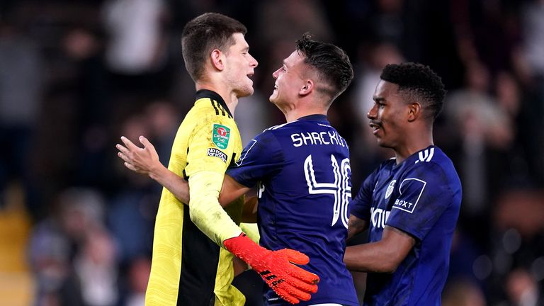 Leeds United goalkeeper Illan Meslier (left) is congratulated by team-mates after saving the decisive penalty