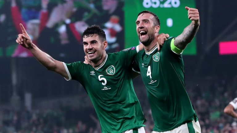 Republic of Ireland's John Egan and Shane Duffy celebrates the own goal of Serbia's Nikola Milenkovic