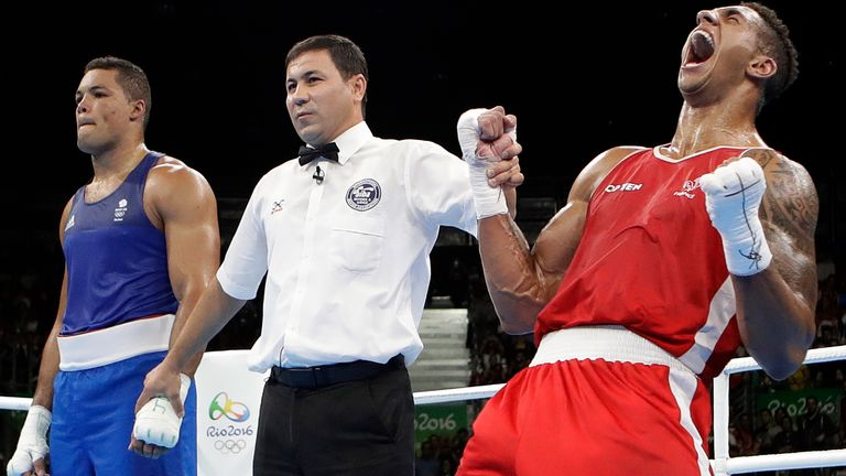 France's Tony Victor James Yoka, right, reacts as he won the gold medal for the men's super heavyweight over 91-kg boxing against Britain's Joe Joyce at the 2016 Summer Olympics in Rio de Janeiro, Brazil, Sunday, Aug. 21, 2016. (AP Photo/Frank Franklin II)