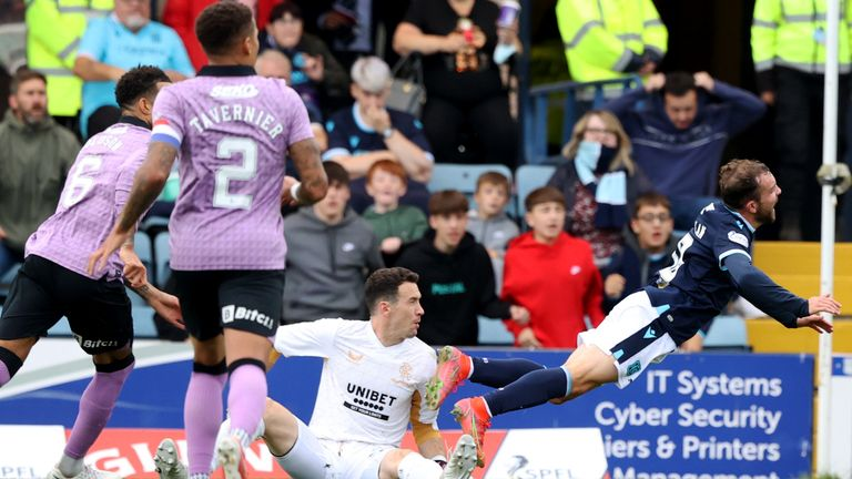DUNDEE, SCOTLAND - SEPTEMBER 25: Jon McLaughlin fouls Paul McMullan and a penalty is awarded during a cinch Premiership match between Dundee and Rangers at the Kilmac Stadium at Dens Park, on September 25, 2021, in Dundee, Scotland. (Photo by Craig Williamson / SNS Group)
