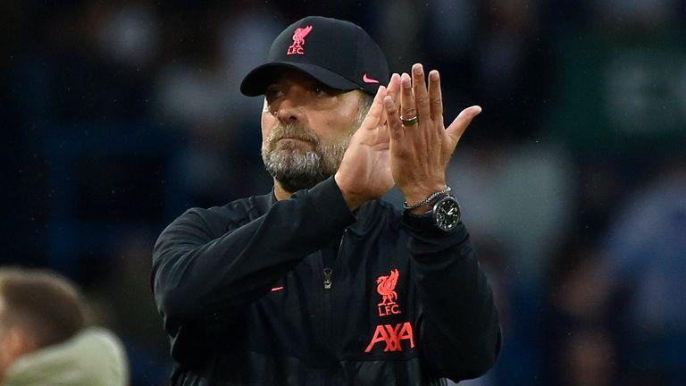 Jurgen Klopp applauds the Liverpool supporters