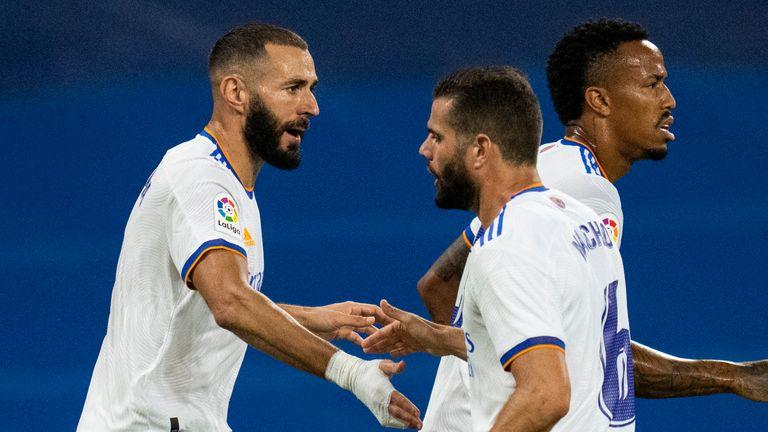 Karim Benzema celebrates his first strike