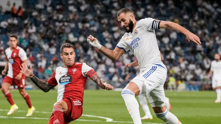 Benzema struck twice as Madrid fought back