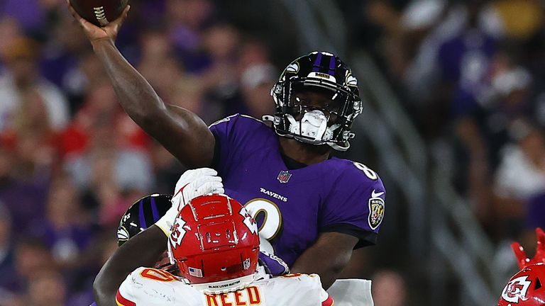 Lamar Jackson throws a touchdown pass to Marquise Brown while in mid-air during the Baltimore Ravens' stunning Sunday night win over the Kansas City Chiefs