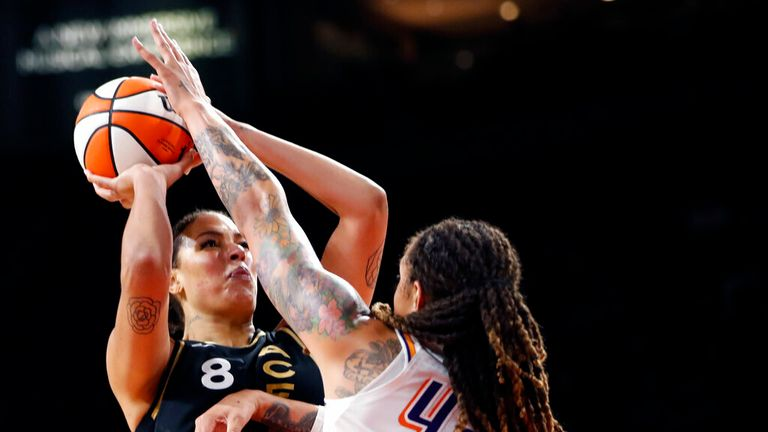 Las Vegas Aces center Liz Cambage (8) takes a shot over Phoenix Mercury center Brittney Griner (42) during the second half of Game 1 in the semifinals of the WNBA playoffs Tuesday, Sept. 28, 2021, in Las Vegas. The Aces beat the Mercury 96-90. (AP Photo/Steve Marcus)