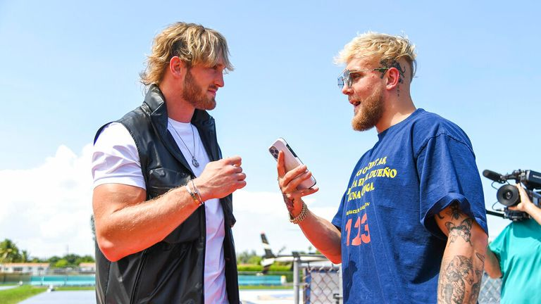 Media personality Logan Paul (left) and brother Jake Paul (right) during a media face-off event on Thursday, May 6, 2021 in Miami Gardens, Fla. (Carlos Goldman/Miami Dolphins via AP)