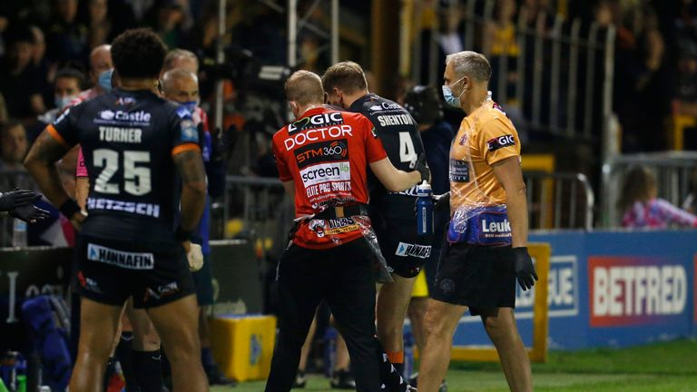 Castleford captain Michael Shenton leaves the pitch after sustaining an injury