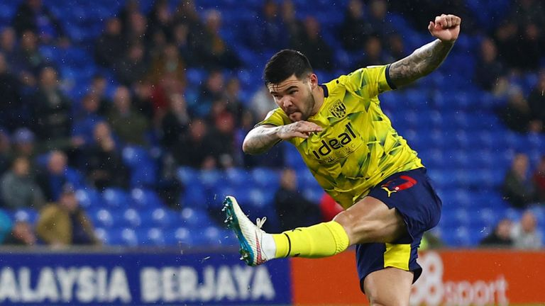 CARDIFF, WALES - SEPTEMBER 28: Alex Mowatt of West Bromwich Albion shoots whilst under pressure from Mark McGuinness of Cardiff City during the Sky Bet Championship match between Cardiff City and West Bromwich Albion at Cardiff City Stadium on September 28, 2021 in Cardiff, Wales. (Photo by Michael Steele/Getty Images)