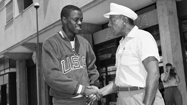 Jesse Owens (right) shakes hands with Boston in the Olympic village in Rome on September 1 in 1960. The pair later became friends