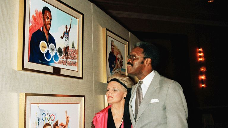 Boston with Pat McCormick near artwork at the Olympic hall of fame in New York in December 1985