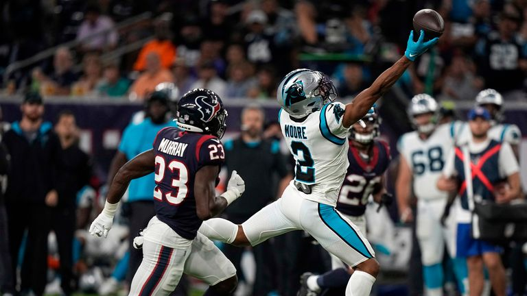Carolina Panthers wide receiver DJ Moore reaches for an incomplete pass as Houston Texans safety Eric Murray defends
